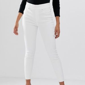 NWT Spanx shape and lift distressed skinny jeans
